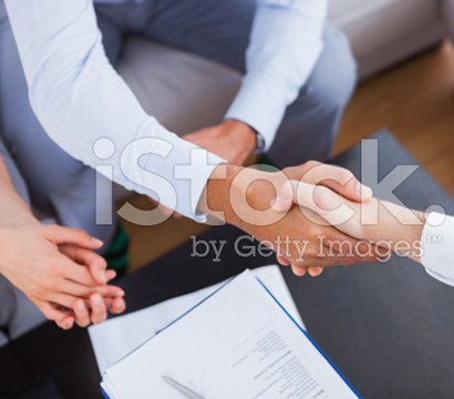 stock-photo-41747266-salesman-shaking-hands-with-client